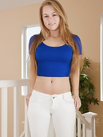 White pants wearing and average-looking teen spreading her pussy lips