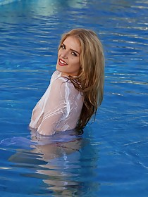 Wet white shirt blonde masturbating on the side of a swimming pool