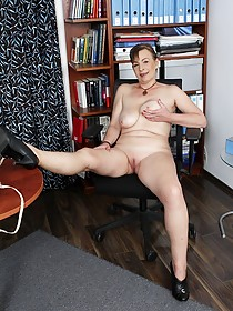 Brunette GILF with natural tits ends up getting naked at the office