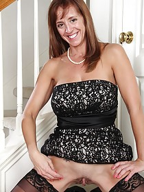 Dress-wearing brunette MILF seductively showing off her labia