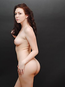 Dark-haired seductress shows her lovely pussy and ass from behind